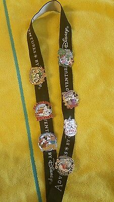 RARE Lot of Adventures by Disney Lot of 7 Pins and Lanyard