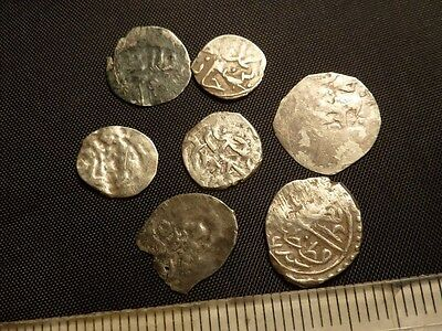 875Lot of 7 Islamic silver coins.