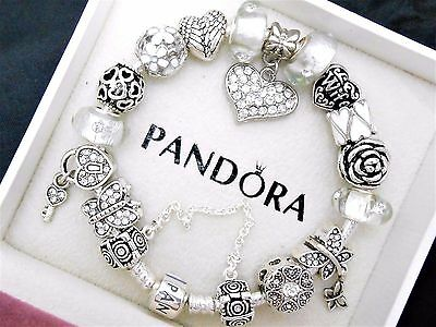 Authentic Pandora Sterling Silver Charm Bracelet With White European Charms.