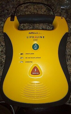 Lot of (2) Defibtech Lifeline AED with Battery and Adult Pad and 4 defibri elect