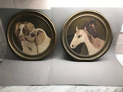 Pair of Antique painted brass wall plaques, dogs and horses