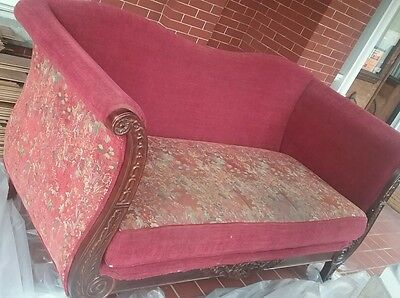 Antique Red Floral Loveseat Couch with Ornate Carved Wooden Trim