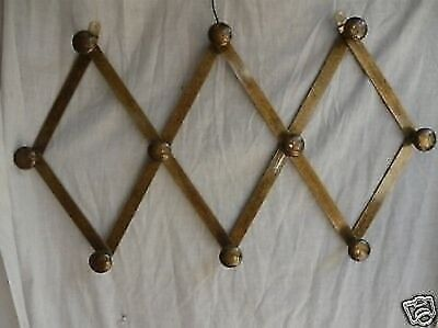 Coat hangers brass burnished with bellows extensible