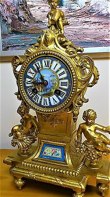 Antique French Ormolu and Serves Porcelain Panel Mantel Clock with Enamel Dial.