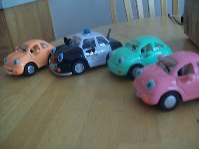 CHEVRON TOY CARS set of four cars.   Numbers 5, 20, 21 and 32