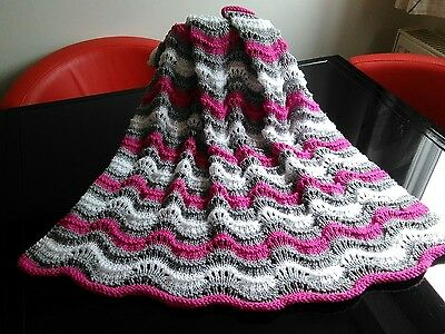 Hand knitted baby blanket Lacy wave design in cerise pink grey and white