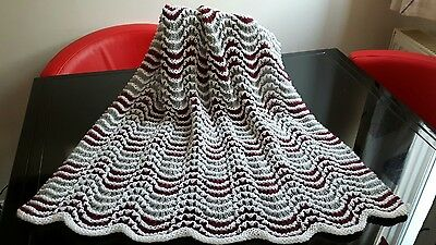 Hand knitted baby blanket Lacy wave design in plum grey and white