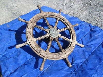 Antique ship's wheel salvaged from the deep barnacles & hub still intact ship