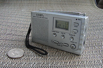 Coby CX53 pocket AM FM radio, digital readout with clock/alarm. Used works fine