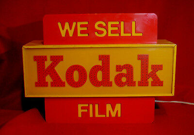 Lighted Sign. 'we Sell Kodak Film'.