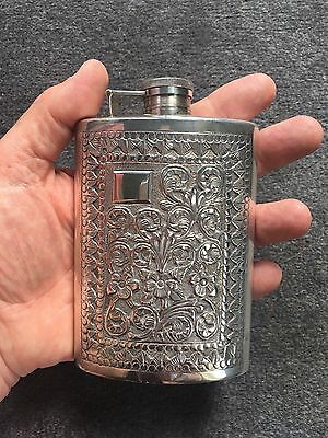 ANTIQUE SOLID SILVER EMBOSSED HIP FLASK. STERLING SILVER . 190gms. 165 ML.