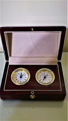 "Double Table Clock Set in wooden case by ""RAPPORT""."
