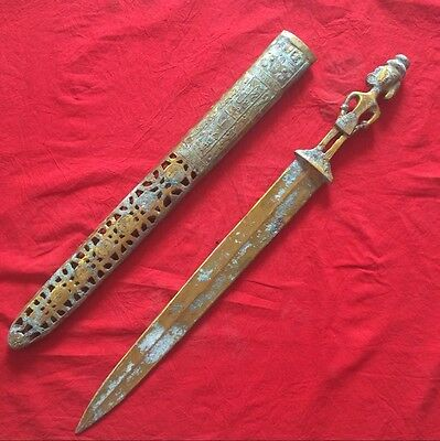 antique       Engraving brass carve dragon sword shang dynasty in ancient China.
