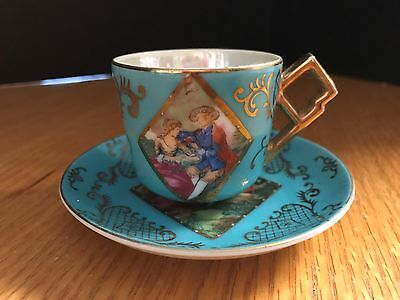 Small Vintage Victorian cup & saucer  turquoise man & woman