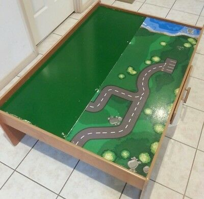 Excellent condition on the wood frame maginarium train table only