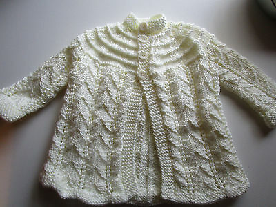 Hand knitted babies wear/matinee jacket,creamy white