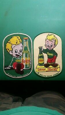 Vintage squirt soda advertising patches.