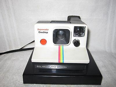 Vintage Polaroid Supercolor Onestep Instant Land camera. Rainbow stripe. Retro