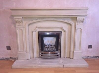 cream stone fireplace hearth and matching mirror