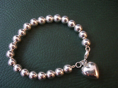 Sterling Silver 8mm Bead with heart charm Bracelet 7.75""