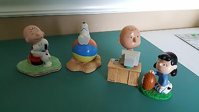 3 Hallmark Peanuts Gallery Figurines and one Lucy