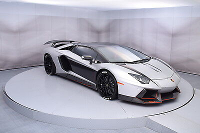 2014 Lamborghini Aventador Roadster in Silver with 4,952 miles 2014 LAMBORGHINI AVENTADOR ROADSTER WRAPPED IN METALLIC SILVER WITH BLACK ACCENT