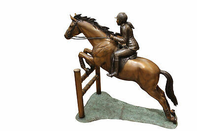 "Jockey and Horse Jump a Fence Bronze Sculpture -  Size: 60""L x 30""W x 51""H."
