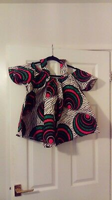 Beautiful African peplum top that can be worn on skirts and trousers in size 8