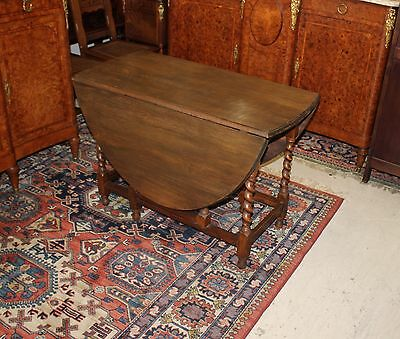 Beautiful English Antique Drop leaf Barley Twist Oval Oak Table.