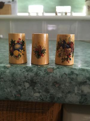 A Trio Of Vintage Wooden Thimbles Depicting Christmas Scenes
