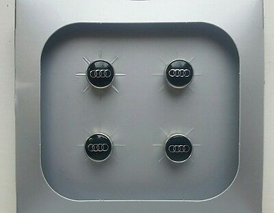 **PRICE REDUCED!** Set of 4 Genuine Audi Valve / Dust caps - 4L0 071 215 A.