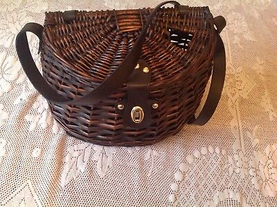 Wicker fishing basket with handleSome use it for their picnic (very stylish)