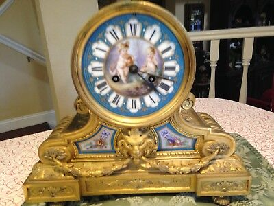 Gilt/Silver Ormolu and Sevres style porcelain mantel clock, made in France, circ