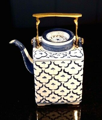 A Beautiful Vintage Blue And White Teapot With Brass Handle