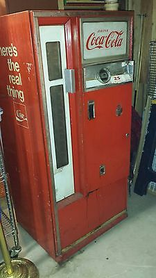 Antique Coca Cola Machine Red, possibly late 50's, cans/bottles fit inside