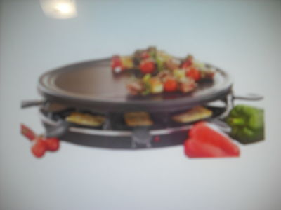 RACLETTE GRILL  with 8 trays.Great for parties