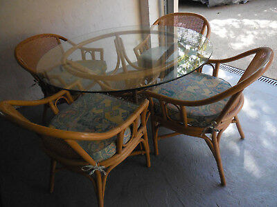 Cane Dining/Kitchen Setting (Glass Top with four chairs and cushions)