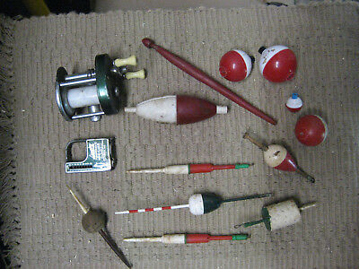 Old Shakespeare fishing reel, tape measure/scale, and vintage floats