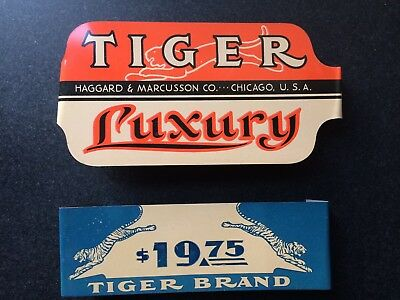 Two (2) Vintage Metal Signs Tiger Brand Luxury Haggard & Marcusson Co
