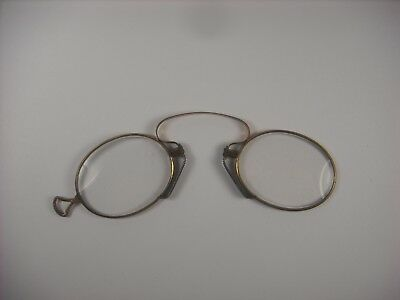 Antique Pince-nez eyeglasses. Gold tone spectacles early 1900's.