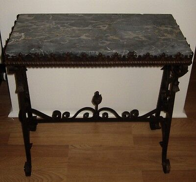 Antique Spanish style wrought iron table with marble top