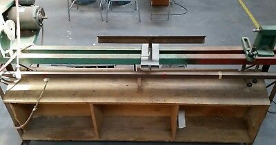 Wood Lathe 5 feet bed on stand belt driven.`