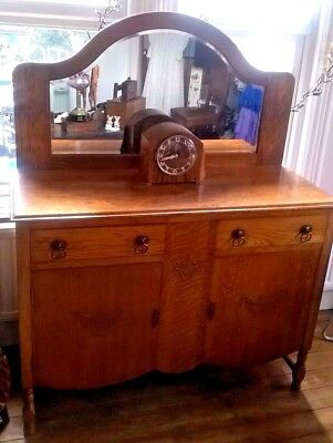 Antique solid oak mirror backed sideboard with cupboard and two drawers
