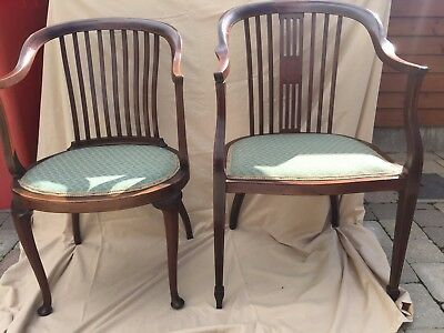 A pair of his / hers antique chairs