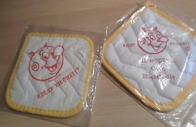 TWO - REDDY KILOWATT magnetic Pot Holders in package with inserts- 2 designs