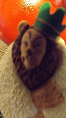 lot of 2 ornaments/lion/dorothy and toto.