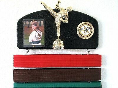 Martial arts belt display with a KICK ! Midn. trophy male.. Delivery is Free