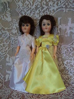 "2 Pretty 11"" Hard Plastic Dolls with Open-Close Eyes - Satiny Gowns - no shoes"