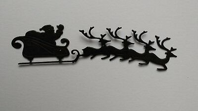 Christmas santa and sleigh black die cuts, packs of 10. Other colours available.