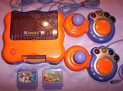 V-Tech  V smile Console. 2 Controllers and 7 Games